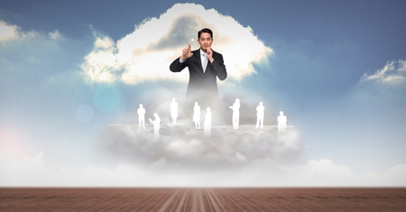 multiracial: Digital composite of Digitally generated image of businessman with employees on clouds