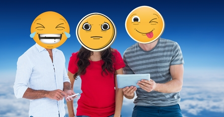 Digital composite of Digitally generated image of friends faces covered with emoji using digital tablet and smart phone a Stock Photo