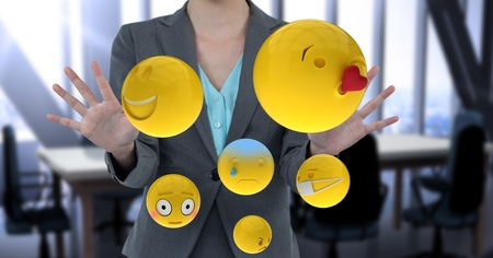 midsection: Digital composite of Midsection of businesswoman with emojis