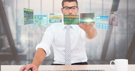 tablet pc in hand: Digital composite of Digitally generated image of businessman touching futuristic screen while working in office