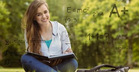 comedor escolar: Compuesto digital de imagen generada digitalmente de fórmulas con estudiante universitaria femenina en segundo plano Foto de archivo