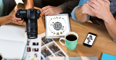 e commerce: Digital composite of High angle view of business people with camera discussing at table in office Stock Photo