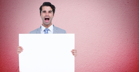 introducing: Digital composite of Portrait of businessman shouting while holding blank billboard against pink background