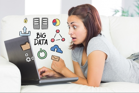 algebra calculator: Digital composite of Digitally generated image of surprised woman using laptop with big data diagram at home Stock Photo