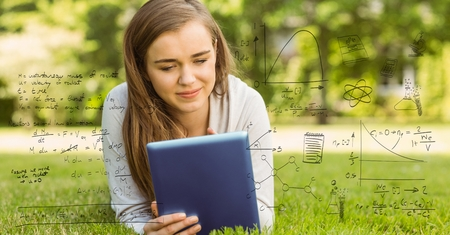 Digital composite of Digitally generated image of various equations with smiling college student using digital tablet in