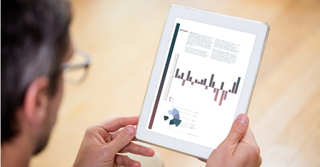 analyst: Digital composite of Businessman analyzing graphs on digital tablet Stock Photo