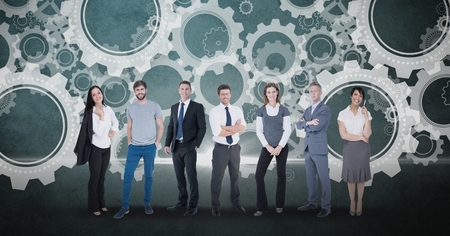 multiracial: Digital composite of Digitally generated image of business people standing against gears in background