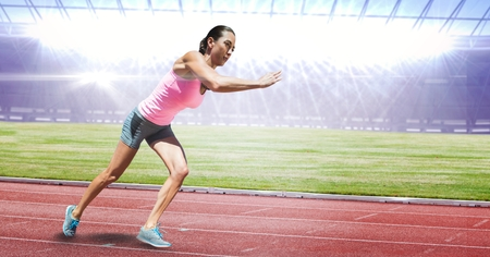 well dressed woman: Digital composite of Full length of female athlete running on racing track