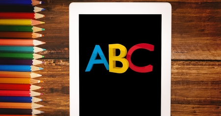 reach out: Digital composite of Alphabets on tablet PC by color pencils Stock Photo