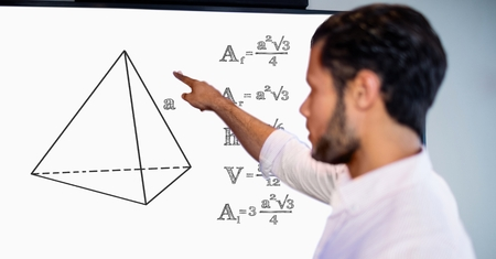 Digital composite of Man pointing over geometric shape by formulas on board Stock Photo