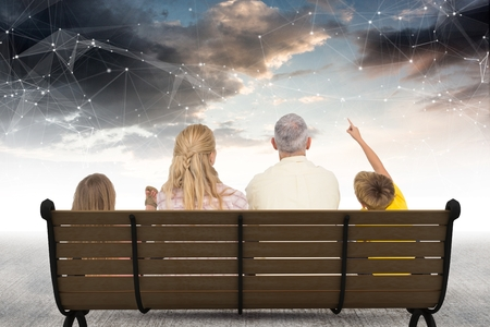 family constellation: Digital composite of Rear view of family sitting on bench against star constellations