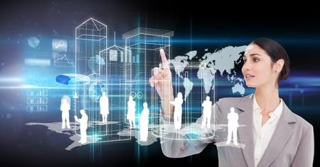 Digital composite of Digital composite image of businesswoman using virtual screen Stock Photo