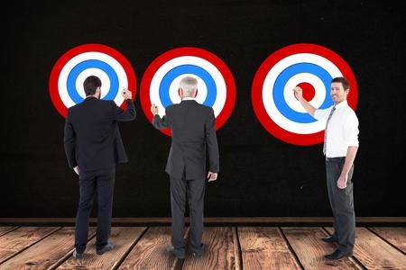 ring flash: Digital composite of Digital composite image of business people setting targets