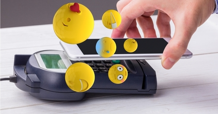 Digital composite of Digital composite image of hand making NFC payment with emojis flying over Stock Photo