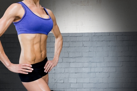 midsection: Digital composite of Midsection of sporty woman with perfect abdominal muscles