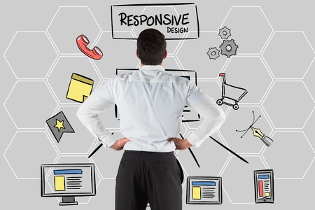 Digital composite of Rear view of businessman looking at responsive design text and icons