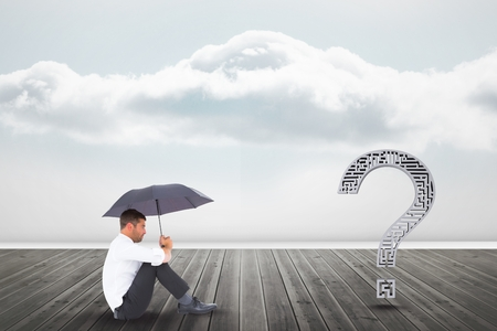 Digital composite of Businessman with umbrella looking at question mark on pier