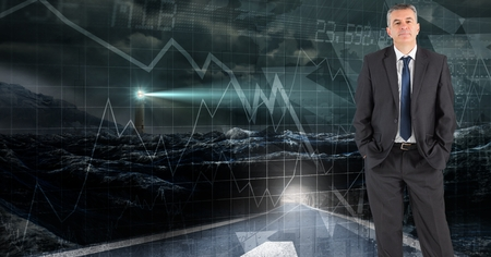 Digital composite of Digital composite image of confident businessman standing against futuristic screen with graphs and 版權商用圖片
