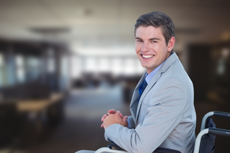 Digital composite of Portrait of businessman sitting on wheelchair in office
