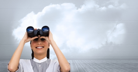 Digital composite of Businesswoman using binoculars against cloudy sky