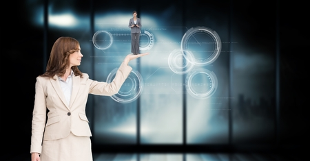 Digital composite of Businesswoman holding employee in palm over abstract background