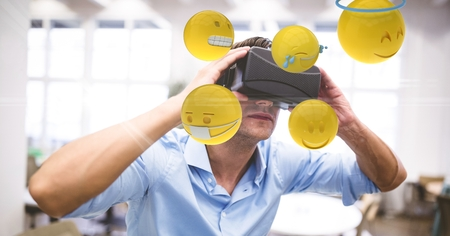 round chairs: Digital composite of Digital composite image of businessman looking at emojis through VR glasses Stock Photo