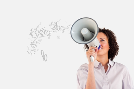 Digital composite of Young businesswoman talking in megaphone Stock Photo