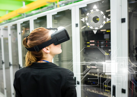 face with headset: Digital composite of Woman wearing VR Virtual Reality Headset with Interface Stock Photo
