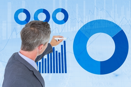 high def: Digital composite of Businessman making graphs on screen