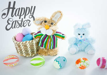 Digital composite of Grey type and stuffed rabbit with easter eggs in basket