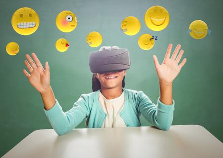 high def: Digital composite of Kid in VR beneath emojis against green chalkboard Stock Photo