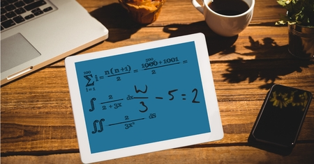 Digital composite of Math equation of tablet PCs screen at outdoor cafe Stock Photo