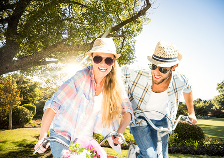 Digital composite of Couple with bikes in the park