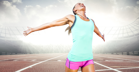 winning pitch: Digital composite of Female runner on track against flares Stock Photo