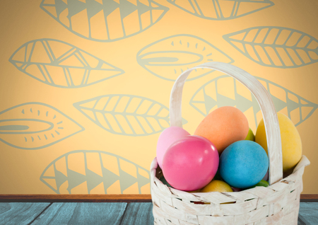 Digital composite of Easter eggs in basket in front of pattern