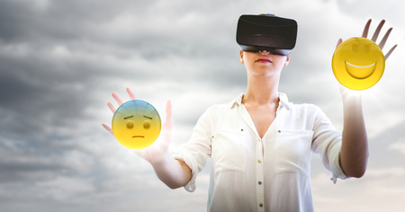 Digital composite of Woman in VR with network and emojis with flares against cloudy sky