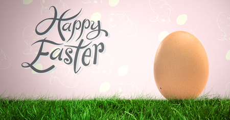 Digital composite of Happy Easter text with Egg in front of rabbit pattern Stock Photo