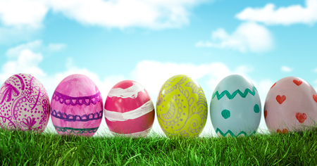 Digital composite of Easter Eggs in front of blue sky Stock Photo