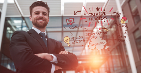 Digital composite of Confident businessman with arms crossed standing by creative process text and icons Stock Photo