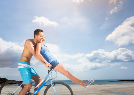 Digital composite of Couple on the bike.