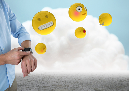 Digital composite of Business man mid section with watch and emojis against cloud and ground Stock Photo