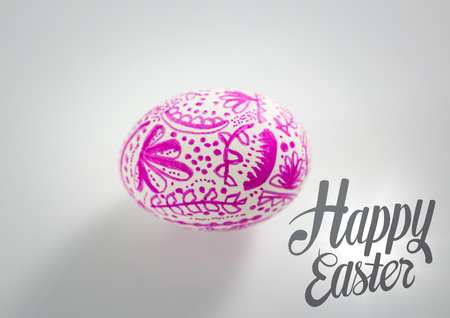 Digital composite of Grey easter graphic and pink patterned egg against white background