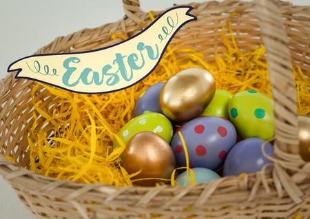 Digital composite of Easter banner against easter eggs in basket
