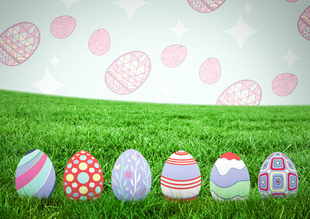 Digital composite of Easter eggs on grass with pattern