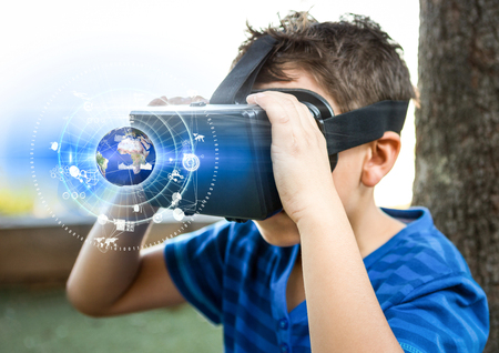 looking through an object: Digital composite of Boy wearing VR Virtual Reality Headset with Interface Stock Photo