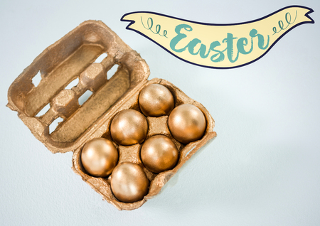 smolder: Digital composite of Easter banner and gold eggs in carton against white background Stock Photo
