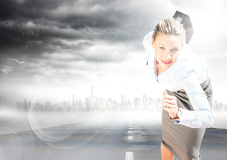 Digital composite of Business woman running with briefcase on road with skyline and storm