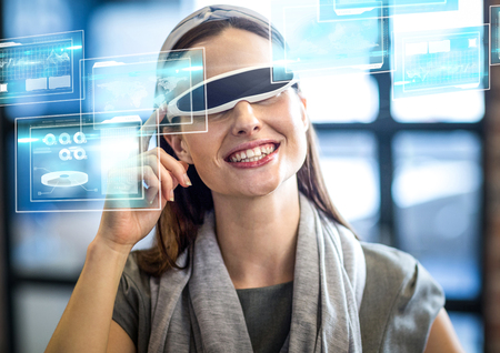 business pitch: Digital composite of Woman wearing VR Virtual Reality Headset with Interface Stock Photo