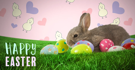 grass blades: Digital composite of Happy Easter text with Easter rabbit with eggs in front of pattern Stock Photo