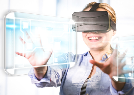 Digital composite of Woman wearing VR Virtual Reality Headset with Interface Stock Photo